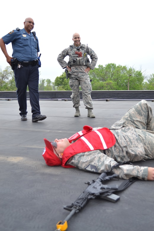 Horsham Police Officer Ramsay Barrington and Staff Sgt. Brian Soto, a 111th Security Forces Squadron member, stand over Master Sgt. Geoffrey Gay, a 201st RED HORSE, Det.1 member, who played the role of an active shooter during a major accident response exercise held at Horsham Air Guard Station, Pa., April 13, 2016. For the past four years, Horsham Police and Fire Departments have participated with Wing members during MAREs. (U.S. Air National Guard photo by Tech. Sgt. Andria Allmond)