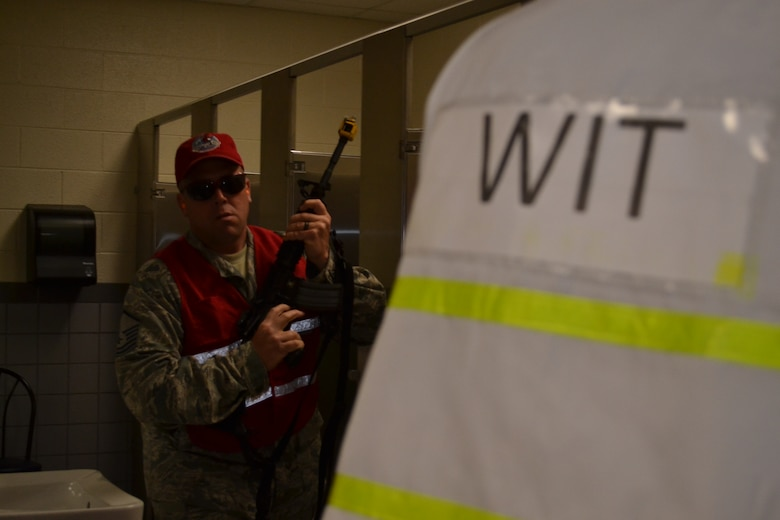 Master Sgt. Geoffrey Gay, a 201st RED HORSE, Det.1 member, plays the part of an active shooter while a wing inspection team (WIT) member watches during a major accident response exercise held at Horsham Air Guard Station, Pa., April 13, 2016. Members of both the Horsham Police Department and the 111th Security Forces Squadron from Horsham AGS worked together to neutralize the dangerous scenario. (U.S. Air National Guard photo by Tech. Sgt. Andria Allmond)