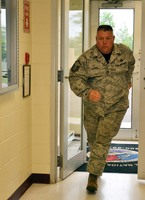 Master Sgt. Richard MacNeal, from the 201st RED HORSE Det. 1, runs to perform a lock down after hearing rifle shots during a major accident response exercise involving an active shooter and mass causalities held at Horsham Air Guard Station, Pa., April 13, 2016. For the recent MARE, planners integrated force protection measures; reaction and response; self-aid and buddy care; and interaction with outside agencies along with the active-shooter element. (U.S. Air National Guard photo by Tech. Sgt. Andria Allmond)