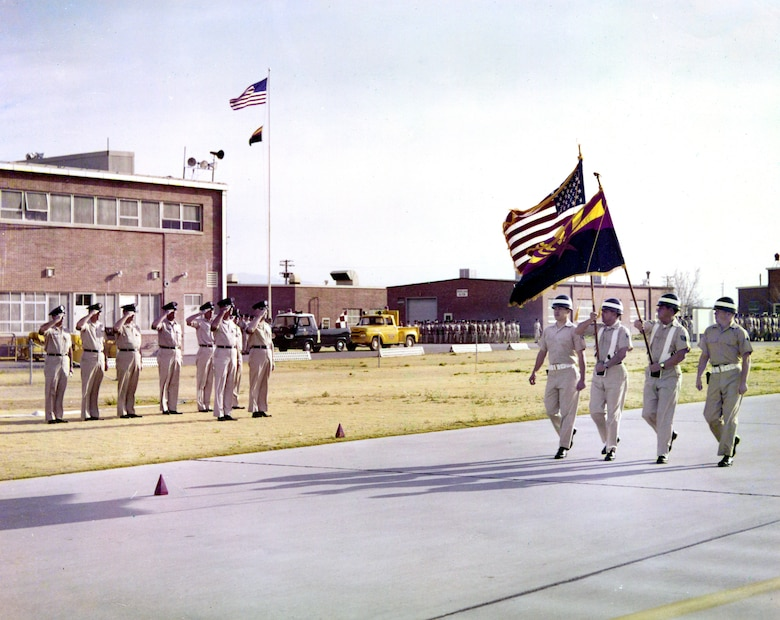 A traditional militia, the predecessor of today's Air and Army National Guard, has a dual-mission obligation to the United States and to its respective state. In this mid-1960s photograph, the passing of colors highlights the Arizona State Flag and the American flag at what was then the 162nd Fighter Group. (U.S. Air National Guard Photo/162nd Wing Historian's Office/Released)