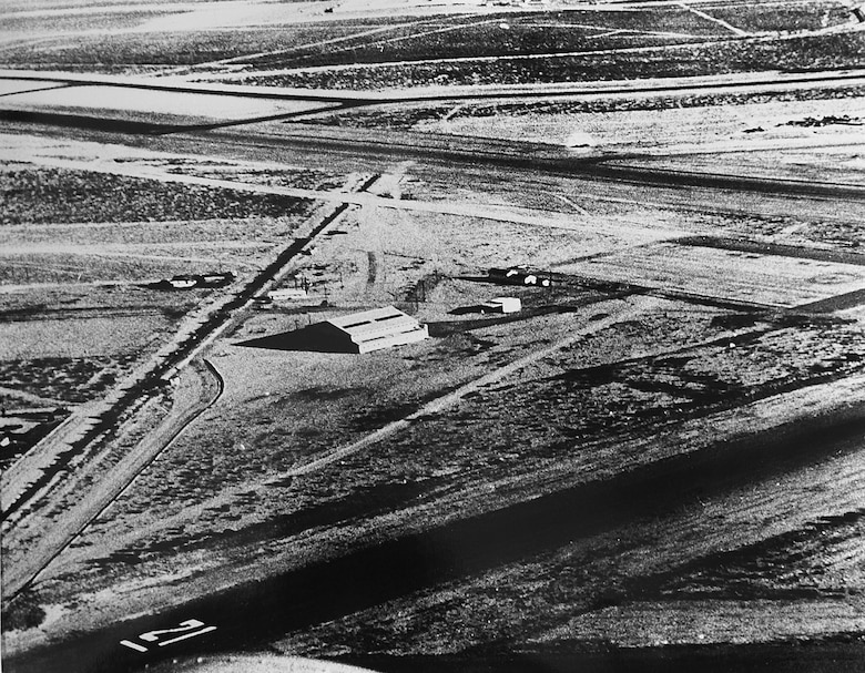 A 1956 aerial photograph showcases the humble beginnings of the 162nd Wing: the original maintenance hangar – along with a ranch house nearby serving as an office – of what was then the 152nd Interceptor Squadron. The small unit in the south Tucson desert would eventually reach wing status, evolving into the finest representation of an Air National Guard base with a global reach. (U.S. Air National Guard Photo/162nd Wing Historian's Office/Released)