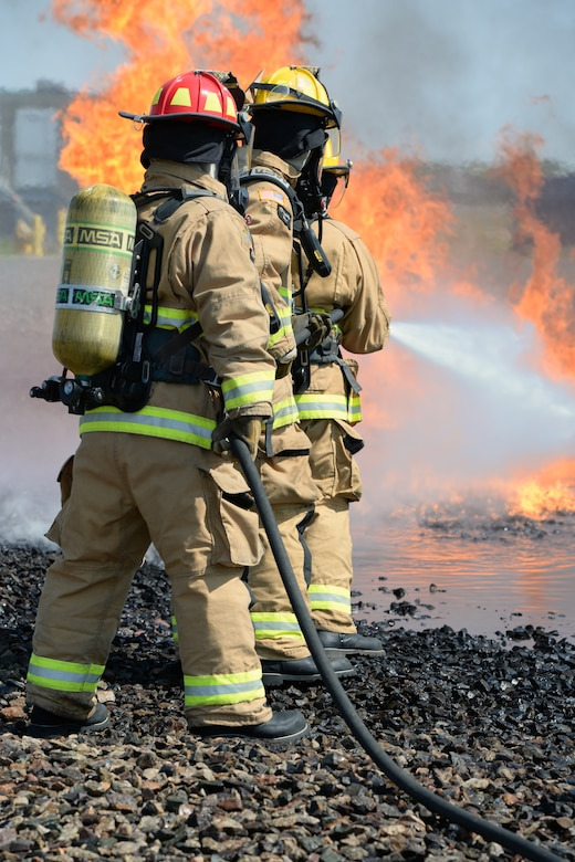 Aircraft rescue firefighters from the 157th Civil Engineer Squadron, Pease Air National Guard Base, N.H., use a handline to extinguish a simulated aircraft structural fire at Logan International Airport, Boston, May 12, 2016.  This is type of training is annual requirement for the firefighters.  (U.S. Air National Guard photo by Staff Sgt. Curtis J. Lenz)