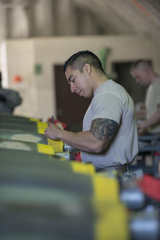 U.S. Air Force Tech. Sgt. Joe Cedillo, the 8th Maintenance Squadron assistant NCO in charge of conventional maintenance, assigned to Kunsan Air Base, Republic of South Korea, labels the settings of a Mark 82 bomb during RED FLAG-Alaska 16-1, May 10, 2016, on Eielson Air Force Base, Alaska. Prior to leaving the warehouse, Cedillo inspects each of the MK 82 bombs prior to them leaving the warehouse to ensure they are labeled accurately. (U.S. Air Force photo by Staff Sgt. Ashley Nicole Taylor/Released)