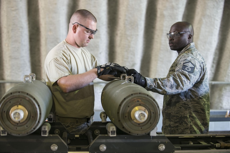 U.S. Air Force Staff Sgt. Thomas Johnson, left, and Master Sgt. Anthonio Dais, members of the 8th Maintenance Squadron, assigned to Kunsan Air Base, Republic of South Korea, assemble a Mark 82 bomb during RED FLAG-Alaska (RF-A) 16-1, May 10, 2016, on Eielson Air Force Base, Alaska. Aircraft Munitions Maintenance Organization Airmen from both Kunsan and Eielson built munitions for exercises RF-A and Northern Edge. (U.S. Air Force photo by Staff Sgt. Ashley Nicole Taylor/Released)