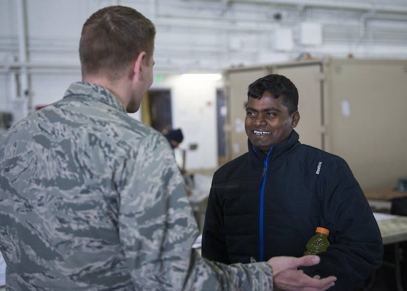 U.S. Air Force Chaplain (Capt) Philip Vincent, a 354th Fighter Wing chaplain, visits with members of the Indian Air Force, May 9, 2016, on Eielson Air Force Base, Alaska. Chaplains assigned to Eielson are charged with ensuring U.S. and partner nation servicemenbers maintain their spiritual fitness while in garrison. (U.S. Air Force Photo by 1Lt Elias Zani/Released)