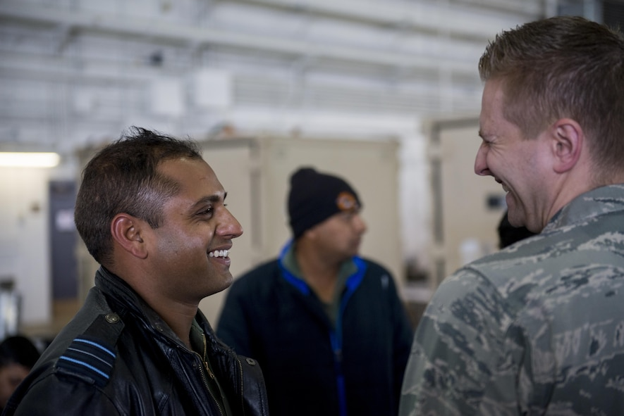 U.S. Air Force Chaplain (Capt) Philip Vincent, a 354th Fighter Wing chaplain, shares a laugh with a member of the Indian Air Force (IAF), May 9, 2016, on Eielson Air Force Base, Alaska. The IAF participated in RED FLAG-Alaska for the first time to trade best practices and strengthen the relationship between U.S. forces and the IAF. (U.S. Air Force Photo by 1Lt Elias Zani/Released)