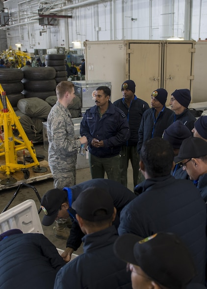 U.S. Air Force Chaplain (Capt) Philip Vincent, a 354th Fighter Wing chaplain, introduces Indian Air Force Airmen to American snack foods, May 9, 2016, on Eielson Air Force Base, Alaska. The Air Force Chaplain Corps provides spiritual care and the opportunity for Airmen, their families, and other authorized personnel to exercise their constitutional right to the free exercise of religion. (U.S. Air Force Photo by 1Lt Elias Zani/Released)