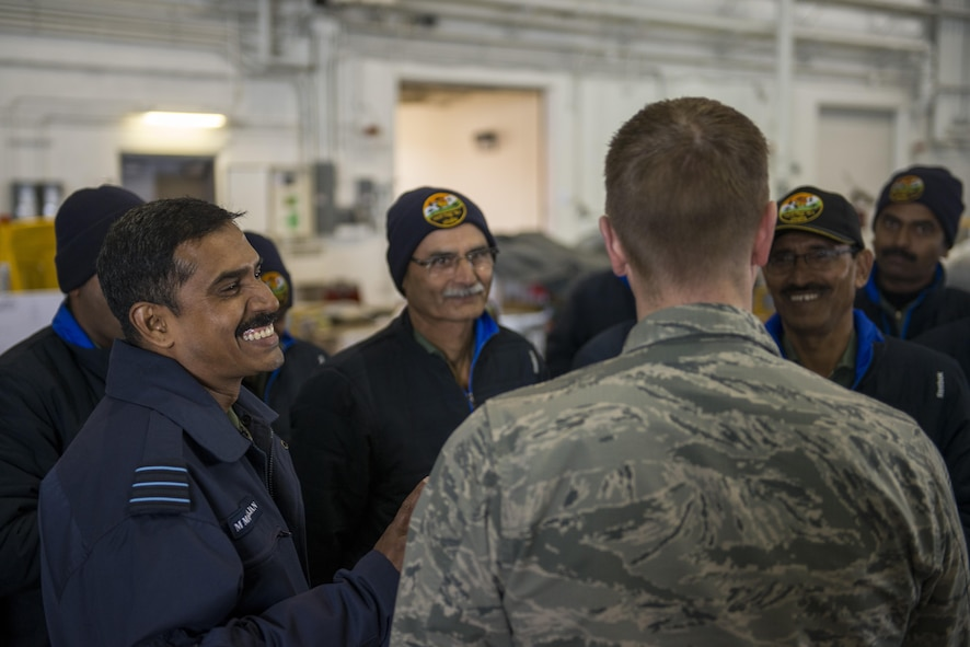 U.S. Air Force Chaplain (Capt) Philip Vincent, foreground, a 354th Fighter Wing chaplain, converses with Indian Air Force Airmen, May 9, 2016, on Eielson Air Force Base, Alaska. During RED FLAG-Alaska exercises, chaplains assigned to the 354th Fighter Wing spoke with various units to boost morale and strengthen relationships with visitors. (U.S. Air Force Photo by 1Lt Elias Zani/Released)