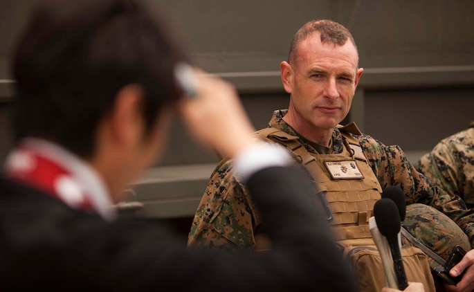 Lt. Col. Neil J. Owens answers questions from Japanese media during an artillery demonstration for Artillery Relocation and Training Program 16-1, in Senjogahara, Japan, May 16, 2016. ARTP is a Japan-funded, routine training exercise that allows Marines with 3rd Battalion, 12th Marine Regiment, 3rd Marine Division, III Marine Expeditionary Force, based out of Camp Hansen, Okinawa, Japan, to conduct live-fire training. Owens, the commanding officer of 3rd Bn., 12th Marines, communicates with Japanese officials about ARTP daily during the exercise. Owens is a native of Medford, Mass.