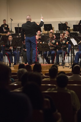 CAMP HANSEN, Okinawa, Japan – The III Marine Expeditionary Force Band performed a tribute dedicated to the victims of the 2011 great East Japan earthquake and the victims in the recent earthquake in Kumamoto at their Spring Concert May 7, 2016 at Tedako Hall, Okinawa, Japan. III MEF Commander Lt. Gen. Lawrence Nicholson, Ginowan City Mayor Atsushi Sakima, Ministry of Foreign Affairs Ambassador Masashi Mizukami and many other distinguished visitors attended the concert. The III MEF Band is comprised of 50 Marines, and performs in over 300 events each year, including the Japan Self-Defense Force Marching Festival, the Cherry Blossom Festival and the Okinawa City Street Parade. (U.S. Marine Corps photo by Cpl. Tiffany Edwards)