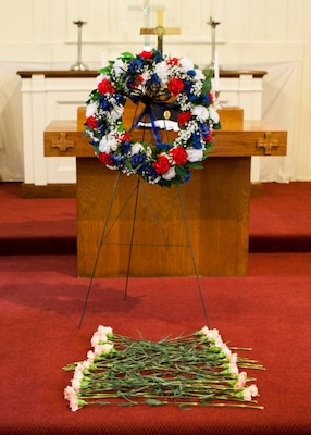 Everyone in attendance was offered the opportunity to place a pink carnation in front of the wreath in honor of the fallen officers at the DLA Distribution National Police Week wreath laying ceremony held on May 18.