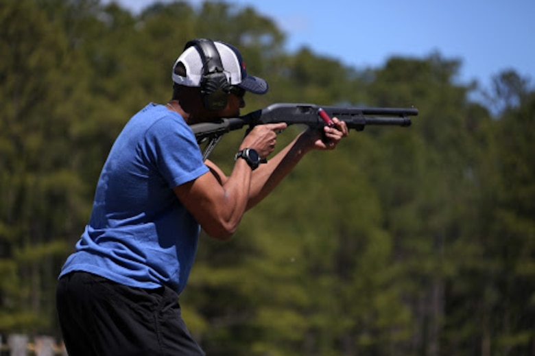 Staff Sgt. Harrison Porquin fires a shotgun during a trap and skeet range at Marine Corps Air Station Cherry Point, N.C., April 14, 2016. Twenty Marines with 2nd Low Altitude Air Defense Battalion's Firearms Mentorship Program utilized their marksmanship skills during the range as part of their firearms safety classes. The mentorship program promotes safe private gun ownership, builds confidence in marksmanship skills and increases Marines combat readiness by familiarizing them with other weapons.  Porquin is a warehouse chief with the battalion. (U.S. Marine Corps photo by Cpl. N.W. Huertas/ Released)