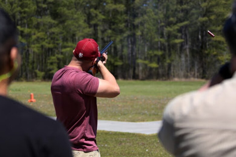 Lance Cpl. David Simmons fires a shotgun during a trap and skeet range at Marine Corps Air Station Cherry Point, N.C., April 14, 2016. Twenty Marines with 2nd Low Altitude Air Defense Battalion's Firearms Mentorship Program utilized their marksmanship skills during the range as part of their firearms safety classes. The mentorship program promotes safe private gun ownership, builds confidence in marksmanship skills and increases Marines combat readiness by familiarizing them with other weapons.  Simmons is an assistant low altitude air defense gunner with the battalion. (U.S. Marine Corps photo by Cpl. N.W. Huertas/ Released)