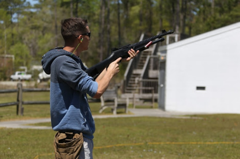 Cpl. Brandon Thomas clears a shotgun during a trap and skeet range at Marine Corps Air Station Cherry Point, N.C., April 14, 2016. Twenty Marines with 2nd Low Altitude Air Defense Battalion's Firearms Mentorship Program utilized their marksmanship skills during the range as part of their firearms safety classes. The mentorship program promotes safe private gun ownership, builds confidence in marksmanship skills and increases Marines combat readiness by familiarizing them with other weapons. Thomas is a radio technician with the battalion. (U.S. Marine Corps photo by Cpl. N.W. Huertas/ Released)