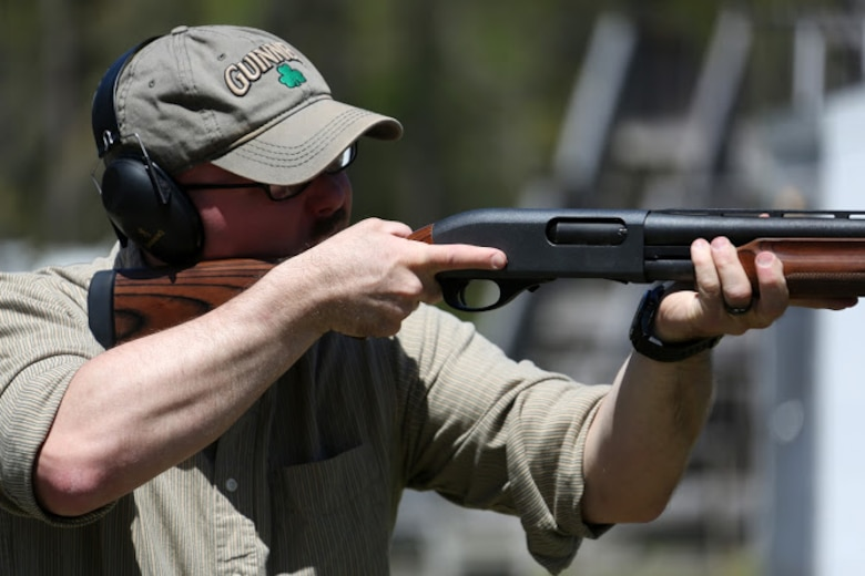 Cpl. Stephen Gomes fires a shotgun during a trap and skeet range at Marine Corps Air Station Cherry Point, N.C., April 14, 2016. Twenty Marines with 2nd Low Altitude Air Defense Battalion's Firearms Mentorship Program utilized their marksmanship skills during the range as part of their firearms safety classes. The mentorship program promotes safe private gun ownership, builds confidence in marksmanship skills and increases Marines combat readiness by familiarizing them with other weapons.  Gomes is a cyber-network operator with the battalion. (U.S. Marine Corps photo by Cpl. N.W. Huertas/ Released)