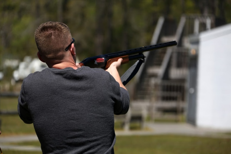 Pfc. Jesse Conti fires a shotgun during a trap and skeet range at Marine Corps Air Station Cherry Point, N.C., April 14, 2016. Twenty Marines with 2nd Low Altitude Air Defense Battalion's Firearms Mentorship Program utilized their marksmanship skills during the range as part of their firearms safety classes. The mentorship program promotes safe private gun ownership, builds confidence in marksmanship skills and increases Marines combat readiness by familiarizing them with other weapons. Conti is a low altitude air defense gunner with the battalion. (U.S. Marine Corps photo by Cpl. N.W. Huertas/ Released)