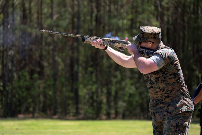 Cpl. Robert Schmitt fires a hunting rifle during a trap and skeet range at Marine Corps Air Station Cherry Point, N.C., April 14, 2016. Twenty Marines with 2nd Low Altitude Air Defense Battalion's Firearms Mentorship Program utilized their marksmanship skills during the range as part of their firearms safety classes. The mentorship program promotes safe private gun ownership, builds confidence in marksmanship skills and increases Marines combat readiness by familiarizing them with other weapons.  Schmitt is a low altitude air defense gunner with the battalion. (U.S. Marine Corps photo by Cpl. N.W. Huertas/ Released)