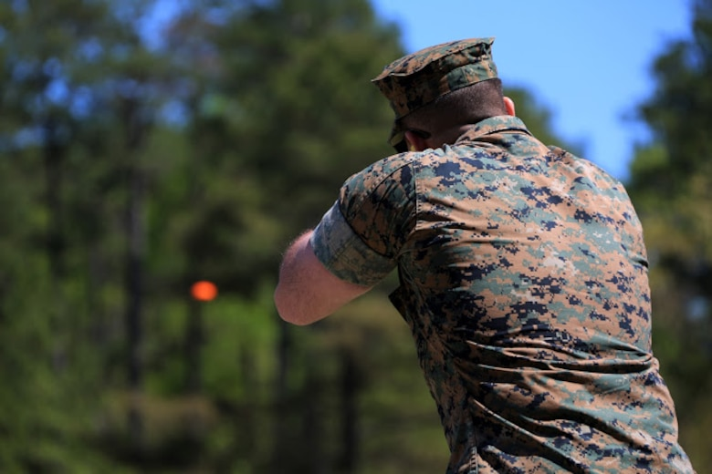 Cpl. Robert Schmitt sights in on a target during a trap and skeet range at Marine Corps Air Station Cherry Point, N.C., April 14, 2016. Twenty Marines with 2nd Low Altitude Air Defense Battalion's Firearms Mentorship Program utilized their marksmanship skills during the range as part of their firearms safety classes. The mentorship program promotes safe private gun ownership, builds confidence in marksmanship skills and increases Marines combat readiness by familiarizing them with other weapons. Schmitt is a low altitude air defense gunner with the battalion. (U.S. Marine Corps photo by Cpl. N.W. Huertas/ Released)