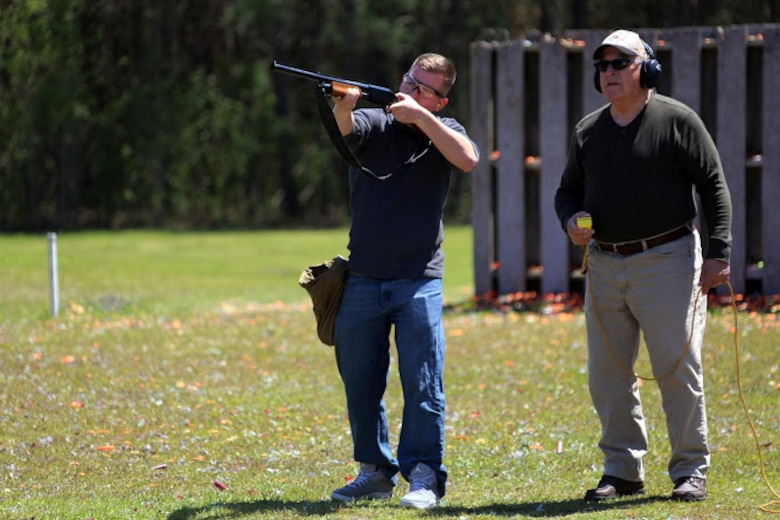 Pfc. Jesse Conti (left) receives guidance from Kevin Driscoll during a trap and skeet range at Marine Corps Air Station Cherry Point, N.C., April 14, 2016. Twenty Marines with 2nd Low Altitude Air Defense Battalion's Firearms Mentorship Program utilized their marksmanship skills during the range as part of their firearms safety classes. The mentorship program promotes safe private gun ownership, builds confidence in marksmanship skills and increases Marines combat readiness by familiarizing them with other weapons. Conti is a low altitude air defense gunner with the battalion and Driscoll is the range safety officer with the MCAS Cherry Point Skeet Club. (U.S. Marine Corps photo by Cpl. N.W. Huertas/ Released)