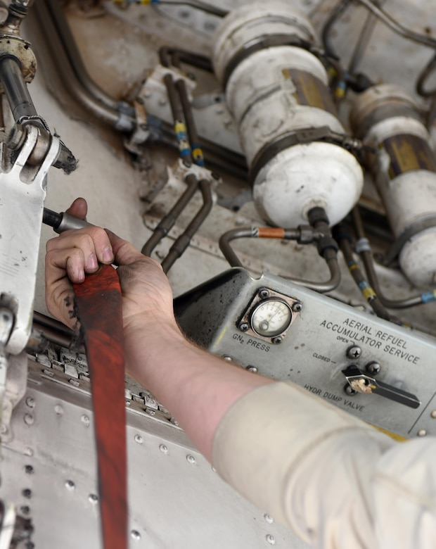 Senior Airman Jason Stach, a 28th Aircraft Maintenance Unit B-1B Lancer aircraft technician, places a safety pin in place to keep the front landing gear doors from closing during maintenance on one of the bombers May 3, 2016, at Dyess Air Force Base, Texas. In order to become a B-1 aircraft technician, Stach had to go through a four-month technical school. Two months of the school consisted of basic aircraft maintenance and terminology and the remainder was hands-on training here at Dyess. (U.S. Air Force photo/Senior Airman Alexander Guerrero)