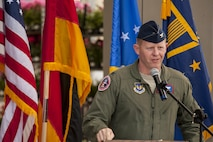 U.S. Air Force Col. Joseph McFall, 52nd Fighter Wing commander speaks, during the grand opening ceremony of the new commissary May 19, 2016, at Spangdahlem Air Base, Germany. The facility is part of the Spangdahlem Evolution, a building plan that includes the Medical Group and the future Spangdahlem Middle School and High School. (U.S. Air Force photo by Senior Airman Rusty Frank/Released)
