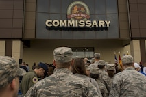 Spangdahlem Airmen walk into the new commissary after the grand opening ceremony May 19, 2016 at Spangdahlem Air Base, Germany. The commissary represents one portion of the Spangdahlem's northwest expansion plan. (U.S. Air Force photo by Senior Airman Rusty Frank/Released)