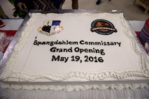 A cake is displayed inside the new Spangdahlem commissary during the grand opening May 19, 2016, at Spangdahlem Air Base, Germany. The new commissary is the first of its kind to incorporate a C02 refrigeration system that cuts down energy costs and reduces the facility's carbon footprint on the environment. (U.S. Air Force photo by Senior Airman Rusty Frank/Released)