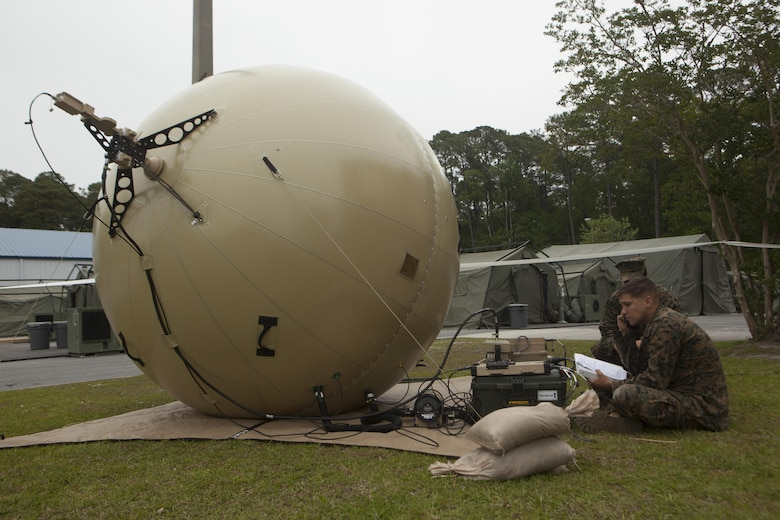 Cpl. Roberto A. Mas and Cpl. Lily Banhegyesi set up network communications through a GATR satellite system during 2nd Marine Aircraft Wing's portion of the II Marine Expeditionary Force Exercise 2016 at Marine Corps Air Station Cherry Point, N.C., May 13, 2016. MEFEX 16 is designed to synchronize and bring to bear the full spectrum of II MEF's command and control capabilities in support of the Marine Air-Ground Task Force.  Mas and Banhegyesi are special intelligence systems communicators with Marine Wing Headquarters Squadron 2. (U.S. Marine Corps photo by Cpl. Austin A. Lewis/Released)