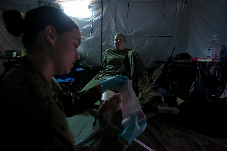 U.S. Navy Seaman 1st Class Alexis L. Ruiall practices providing aid to a sprained ankle during 2nd Marine Aircraft Wing's portion of the II Marine Expeditionary Force Exercise 2016 at Marine Corps Air Station Cherry Point, N.C., May 13, 2016. MEFEX 16 is designed to synchronize and bring to bear the full spectrum of II MEF's command and control capabilities in support of the Marine Air-Ground Task Force.   Ruiall is a corpsman with Marine Tactical Electronic Warfare Squadron 2. (U.S. Marine Corps photo by Cpl. Austin A. Lewis/Released)