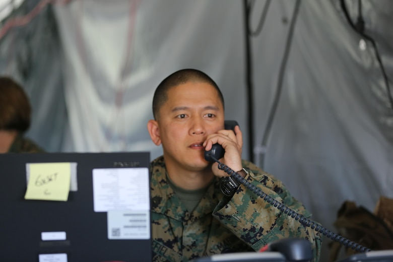 Gunnery Sgt. Edgar R. Grefiel makes a phone call during 2nd Marine Aircraft Wing's portion of the II Marine Expeditionary Force Exercise 2016 at Marine Corps Air Station Cherry Point, N.C., May 15, 2016.  MEFEX 16 is designed to synchronize and bring to bear the full spectrum of II MEF's command and control capabilities in support of the Marine Air-Ground Task Force. Grefiel is an administrative operations chief with Marine Wing Headquarters Squadron 2.  (U.S. Marine Corps photo by Lance Cpl. Mackenzie Gibson/Released)