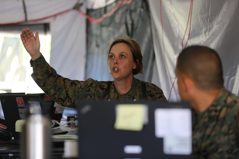 Lt. Col. Regina Gustavsson explains the circumstances of a simulated mishap during 2nd Marine Aircraft Wing's portion of the II Marine Expeditionary Force Exercise 2016 at Marine Corps Air Station Cherry Point, N.C., May 11, 2016.  MEFEX 16 is designed to synchronize and bring to bear the full spectrum of II MEF's command and control capabilities in support of the Marine Air-Ground Task Force. Gustavsson is the assistant chief of staff, G-1 administration, 2nd MAW. (U.S. Marine Corps photo by Lance Cpl. Mackenzie Gibson/Released)