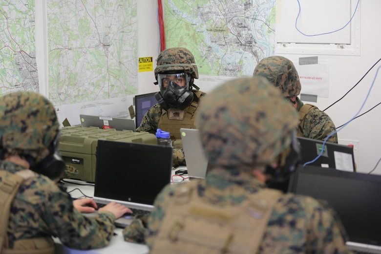 Marines continue to work while wearing their gas masks during a mock chemical, biological, radiological and nuclear defense drill, during 2nd Marine Aircraft Wing's portion of the II Marine Expeditionary Force Exercise 2016 at Marine Corps Air Station Cherry Point, N.C., May 15, 2016. During MEFEX 16, 2nd MAW conducted an incoming CBRN drill to ensure that the Marines knew how to react quickly and use their equipment properly. MEFEX 16 is designed to synchronize and bring to bear the full spectrum of II MEF's command and control capabilities in support of the Marine Air-Ground Task Force.   (U.S. Marine Corps photo by Staff Sgt. Rebekka S. Heite/Released)