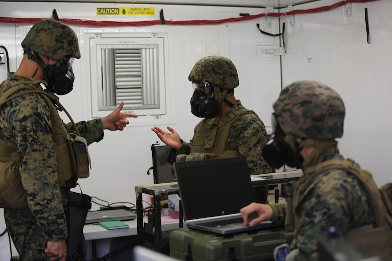 Marines communicate with each other during a mock chemical, biological, radiological and nuclear defense drill in 2nd Marine Aircraft Wing's portion of the II Marine Expeditionary Force Exercise 2016 at Marine Corps Air Station Cherry Point, N.C. May 15, 2016. The purpose of the drill was to ensure that the Marines knew how to react quickly and use their equipment properly. MEFEX 16 is designed to synchronize and bring to bear the full spectrum of II MEF's command and control capabilities in support of the Marine Air-Ground Task Force. (U.S. Marine Corps photo by Staff Sgt. Rebekka S. Heite/Released)