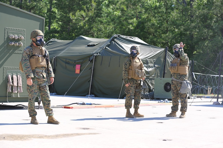 Marines participate in a chemical, biological, radiological and nuclear defense drill during 2nd Marine Aircraft Wing's portion of the II Marine Expeditionary Force Exercise 2016 at Marine Corps Air Station Cherry Point, N.C., May 15, 2016. The purpose of the drill was to ensure that the Marines know how to react quickly and use their equipment properly. MEFEX 16 is designed to synchronize and bring to bear the full spectrum of II MEF's command and control capabilities in support of the Marine Air-Ground Task Force. (U.S. Marine Corps photo by Staff Sgt. Rebekka S. Heite/Released)