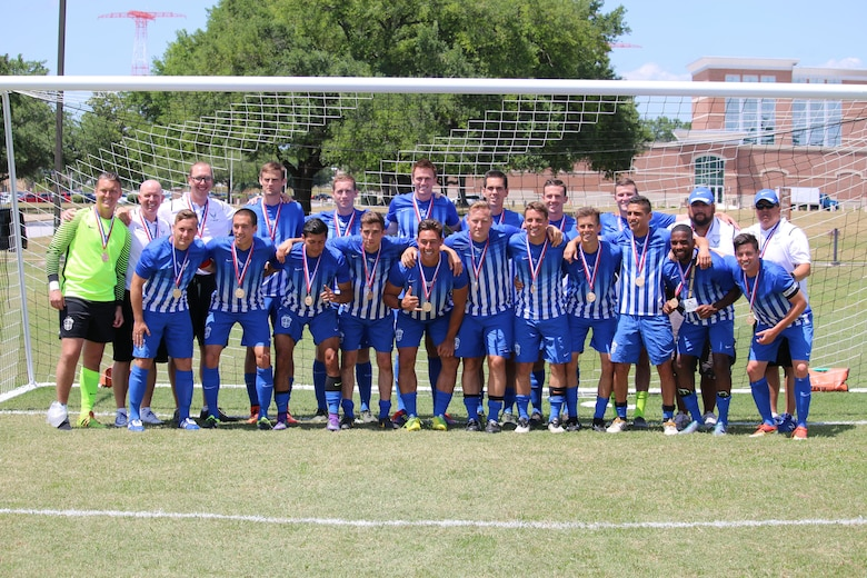 Members of the Air Force soccer team with their gold medals after winning the 2016 Armed Forces Men's Soccer Championship at Fort Benning, Ga., May 13, 2016. Air Force prevailed in their rematch against Navy 3-2 on May 13 to capture the gold after a weeklong tournament at Fort Benning. (Courtesy photo/Steven Dinote)