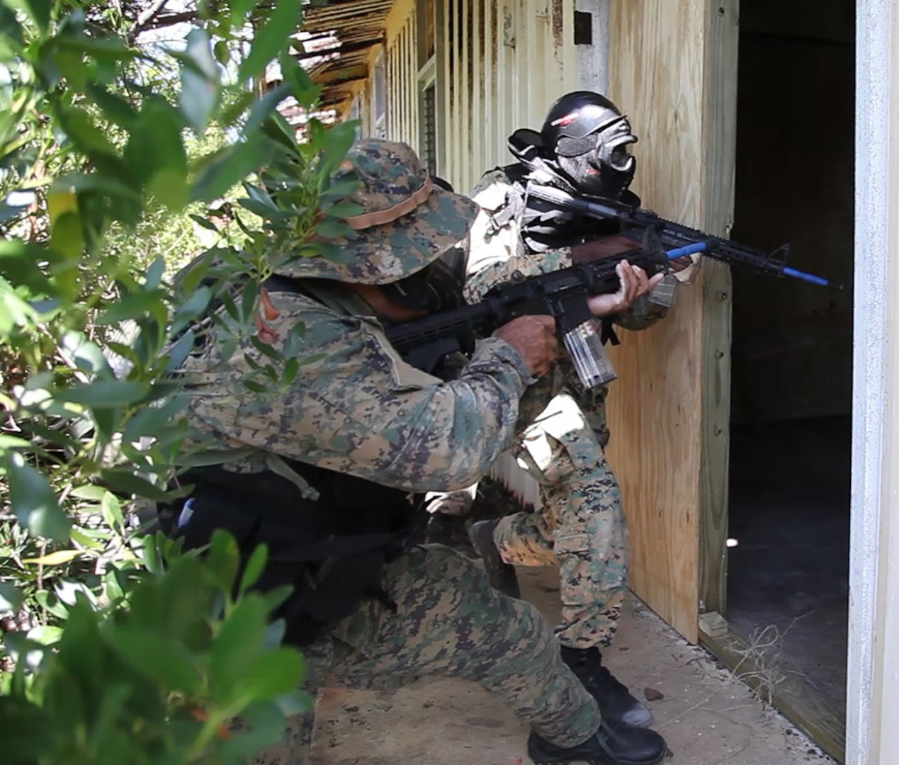 Royal Bahama Defence Force Commandos breach a room as part of a simulated interdiction exercise during Marlin Shield on Pike Cay, Bahamas May 10, 2016. Marlin Shield promotes interoperability between the RBDF, U.S. Northern Command, and U.S. Special Operations Command North and allows both nations to combat terrorism and illicit trafficking in the Caribbean region.