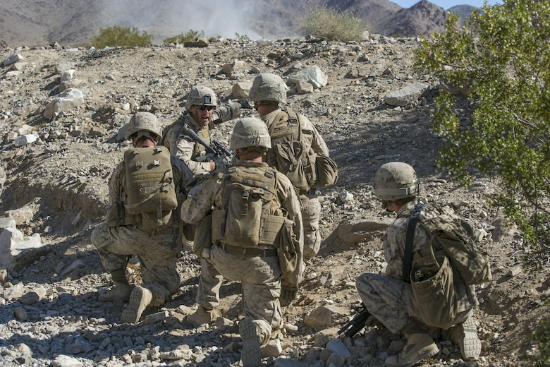 Cpl. John C. Fisher, squad leader, 2nd Battalion, 8th Marine Regiment, leads his Marines through Range 410 while participating in Integrated Training Exercise 3-16 aboard the Marine Corps Air Ground Combat Center, Twentynine Palms, Calif., May 9, 2016. 2/8 came from Marine Corps Base Camp Lejeune, N.C., to participate in ITX 3-16. (Official Marine Corps photo by Lance Cpl. Dave Flores/Released)