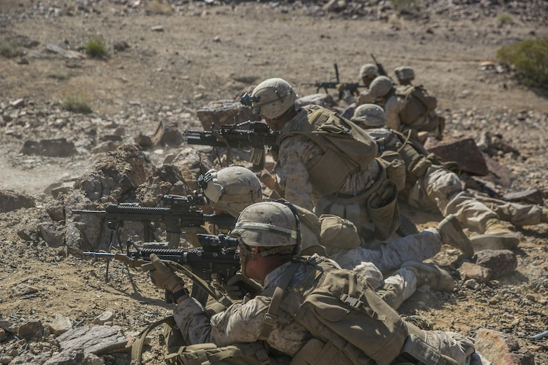 Marines with 2nd Battalion, 8th Marine Regiment, position themselves to lay down suppressive fire at Range 410 while participating in Integrated Training Exercise 3-16 aboard Marine Corps Air Ground Combat Center, Twentynine Palms, Calif., May 9, 2016. 2/8 came from Marine Corps Base Camp Lejeune, N.C., to participate in ITX 3-16. (Official Marine Corps photo by Lance Cpl. Dave Flores/Released)