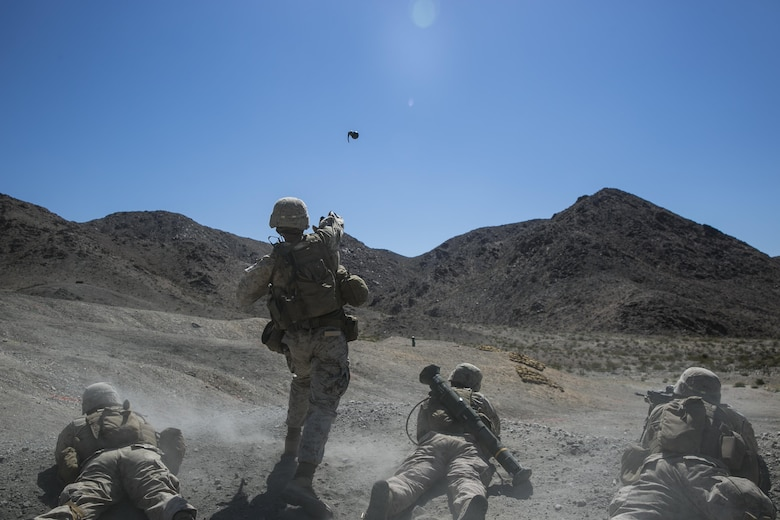 Sgt. Kyle Kimbriel, squad leader, 2nd Battalion, 8th Marine Regiment, throws an M67 hand grenade to clear out targets on at Range 410 while participating in Integrated Training Exercise 3-16 aboard Marine Corps Air Ground Combat Center, Twentynine Palms, Calif., May 9, 2016. 2/8 came from Marine Corps Base Camp Lejeune, N.C., to participate in ITX 3-16. (Official Marine Corps photo by Lance Cpl. Dave Flores/Released)