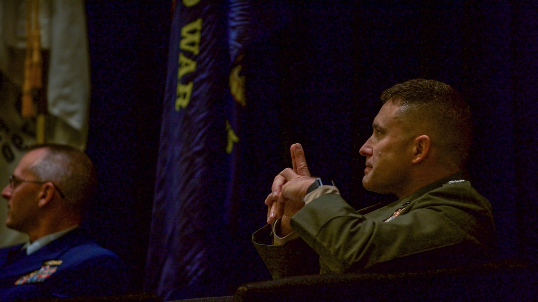 Col. James Jenkins, director for the Science and Technology Division, Marine Corps Warfighting Laboratory/Future Directorates, Marine Corps Combat Development Command, observes a presentation on technology in the military during the Evolution of the Human Machine Team panel at the Gaylord National Convention Center at National Harbor, Maryland, May 17, 2016, as part of the Navy League of the United States Sea, Air, Space Exposition.