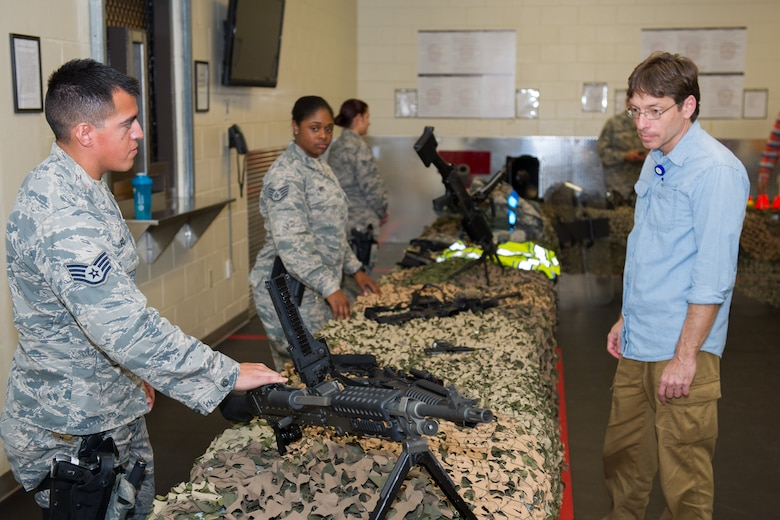 The 45th Security Forces Squadron held an open house at Patrick Air Force Base, Fla., May 18, 2016, during National Police Week, to honor all law enforcement and first responders who have made the ultimate sacrifice. The open house included a Military Working Dog demonstration and a tour of the holding cells, dispatch center, mobile command post, weapons display, and patrol vehicles. This year's National Police Week dates are May 15-21. (U.S. Air Force photos/Benjamin Thacker/Released)