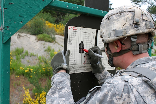 A soldier marks a target during training to qualify on the M4 carbine at Joint Base Lewis-McChord, Wash., May 18, 2016. The routine training allows soldiers to improve basic skills and increase unit readiness. The soldiers are assigned to Headquarters Battery, 17th Field Artillery Brigade. Army photo by Capt. Tania Donovan