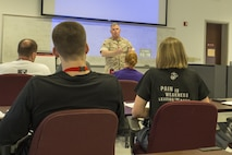 Colonel Terence D. Trenchard welcomes participants to the 2016 Marine Corps Recruiting Command Coaches Workshop aboard Marine Corps Base Quantico, Virginia, May 19, 2016. The Coaches Workshop helps build meaningful and purposeful relationship with those who have the privilege to guide America's leaders of tomorrow. Trenchard currently serves as the chief of staff for MCRC.