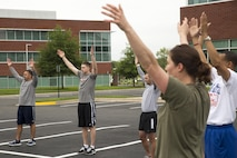 Collegiate sports coaches from across the nation physically train with Marines as part of the 2016 Coaches Workshop in Dumfries, Virginia, May 19, 2016. During the three-day workshop, Marines demonstrate the importance of leadership and ethics in the Corps.
