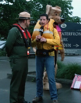 Monty Biggs, Portland District park ranger is interviewed by KGT-TV reporter, Drew Carney. Biggs and other U.S. Army Corps of Engineers and Oregon State Marine Board representatives appeared live on Portland's KGW-TV to talk about water safety, explain how life jackets save lives and demonstrate different life jacket styles. One heroic team member was pushed into the Willamette River to show the effects of cold water immersion and confirm the critical job of a life jacket.