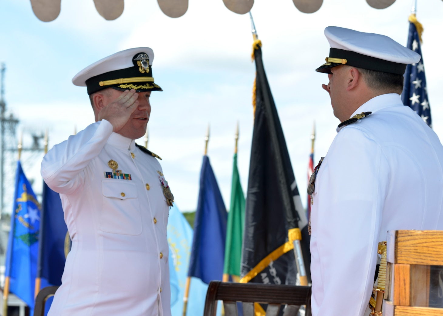 JOINT BASE PEARL HARBOR-HICKAM, Hawaii (May 18, 2016) Commander Michael D. Eberlein, left, relieves Cmdr. Lawrence D. Ollice, right, during the Naval Submarine Support Command (NSSC) Pearl Harbor change-of-command ceremony in Joint Base Pearl Harbor-Hickam.  NSSC provides quality operational support for Pearl Harbor homeported submarines, their crews, families, and the staffs of Submarine Squadrons 1 and 7. (U.S. Navy photo by Mass Communication Specialist 2nd Class Michael H. Lee)