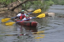 Lance Cpl. Bobby Magruder, big buddy, has fun canoeing with little buddy John Clark at Camp Rainbow recently.