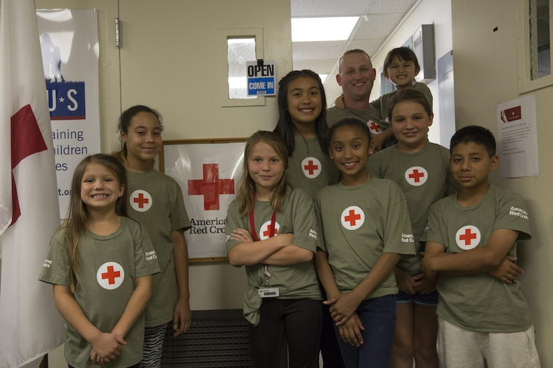 Members of the American Red Cross Youth Club participate in the ARCYC's Homework Helper Club at the Village Center May 5, 2016. The Homework Helper Club provides students with a supportive learning environment every Thursday at 5 p.m. (Official Marine Corps photo by Cpl. Connor Hancock/Released)