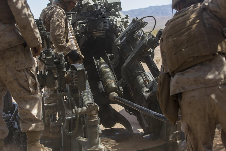 Marines with 3rd Battalion, 11th Marine Regiment, prepare to fire a 155mm M777A2 Lightweight Towed Howitzer in the Lead Mountain Training Area aboard the Marine Corps Air Ground Combat Center Twentynine Palms, Calif., May 3, 2016. (Official Marine Corps photo by Lance Cpl. Levi Schultz/Released)