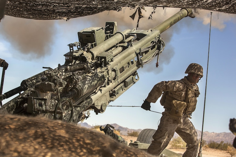 A Marine with 3rd Battalion, 11th Marine Regiment, fire a 155mm M777A2 Lightweight Towed Howitzer in the Lead Mountain Training Area aboard the Marine Corps Air Ground Combat Center Twentynine Palms, Calif., May 3, 2016. (Official Marine Corps photo by Lance Cpl. Levi Schultz/Released)